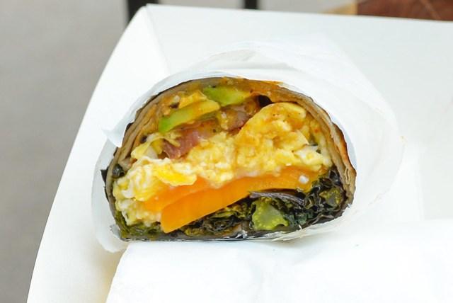 Neuske's Bacon Burrito scrambled eggs, charred kale, cheddar, avocado, arbol chile