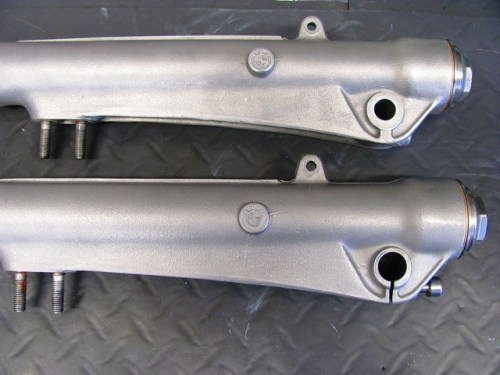 Fork Sliders, Top is Right Side, Bottom is Left Side with Axle Clamp Allen Head Screw