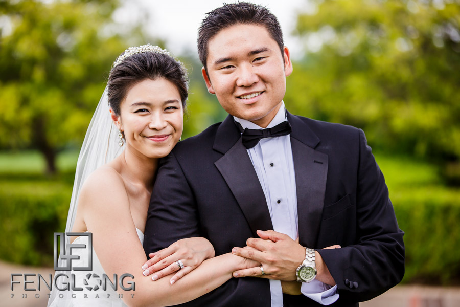 Chinese bride and groom pose for portraits after the wedding ceremony