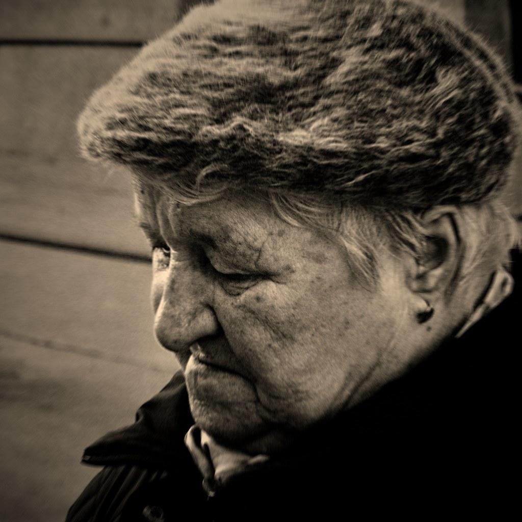 Elderly Woman at Tram Stop
