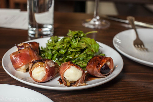 Cheese-stuffed figs wrapped in speck