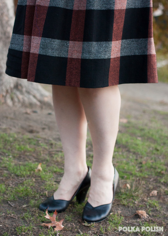 Black Royal Vintage Marilyn pumps are the perfect finishing touch with a collegiate black, rust, and grey plaid skirt