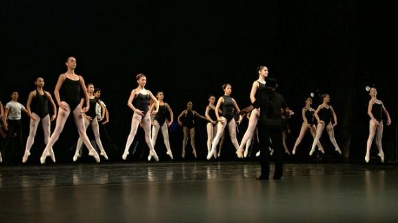 Ballerinas in mid air
