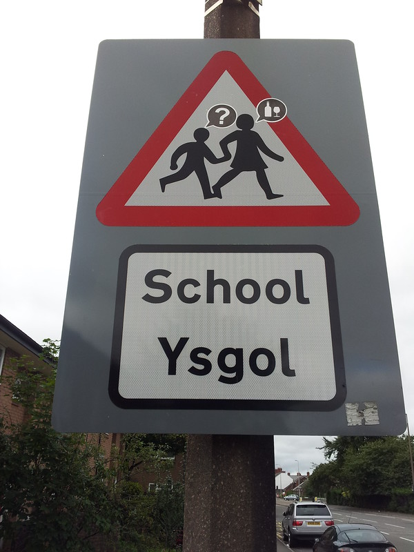 School crossing sign with stickers