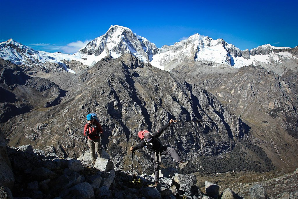 Over boulder fields towards the glaciar of Urus Este(5420m). From left to right: Ishinca (5530m), Ranrapalca (6162m), Ocshapalca (5881m) and Vallunaraju (5686m). Cordillera Blanca. Peru.