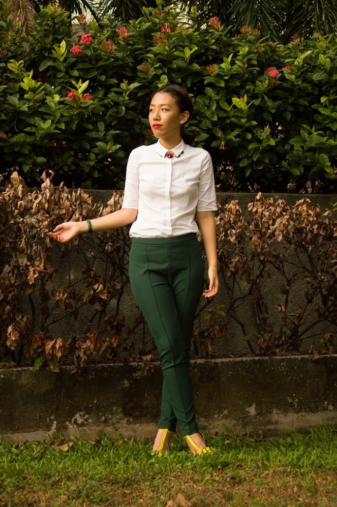 white short sleeved blouse, green pants, twisted hairstyles, yellow heels, red necklace