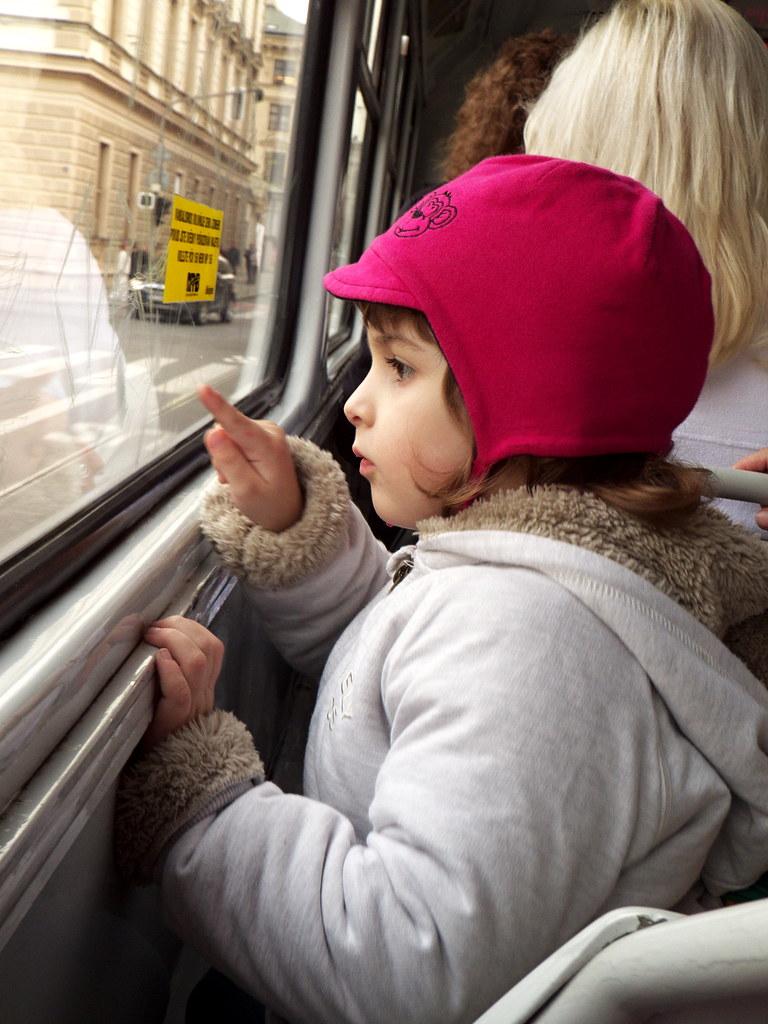 Little Girl Looking from Tram Window