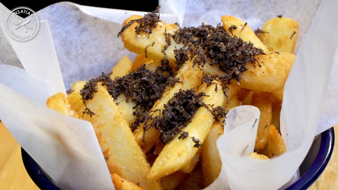 Golden fries, topped with freshly shaved truffles