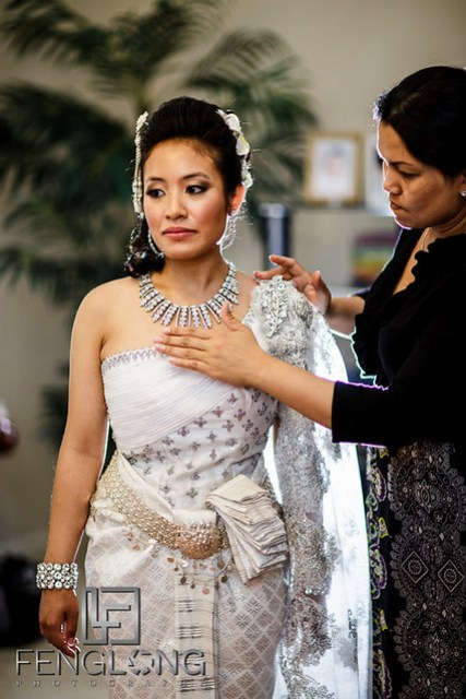 Cambodian bride puts on traditional wedding dress