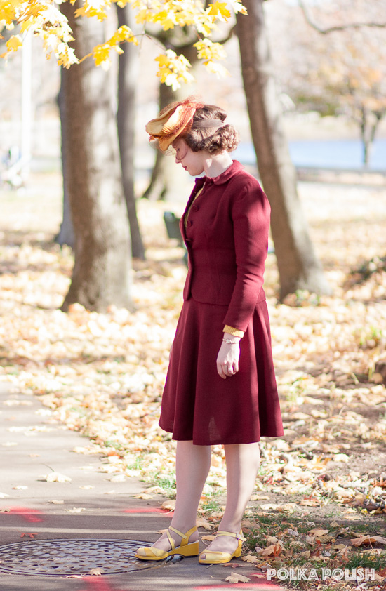 Vintage 1940s inspired fall outfit with a burgundy red suit and goldenrod yellow accessories