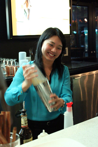 Joyce makes a cocktail