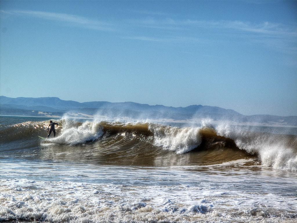 Riding the surf at Jeffreys Bay