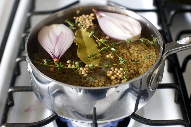 lentils cooking with bay, thyme and shallot