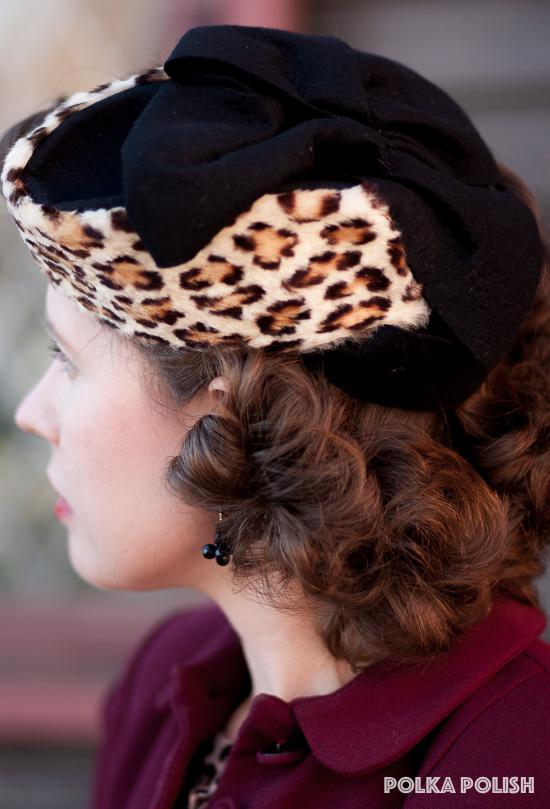Vintage 1940s military-inspired leopard-print fur and black felt tilt hat