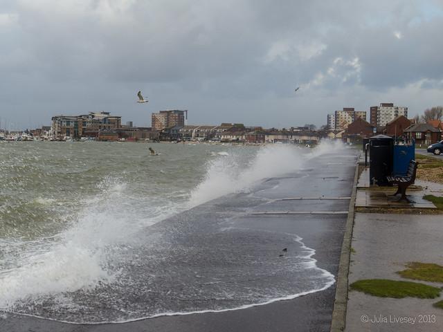 Waves break over the Baiter at high tide