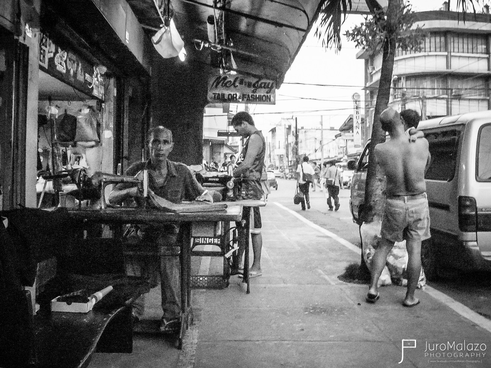 Tailor. (Out on the Streets: Street Photography by Juro Malazo)