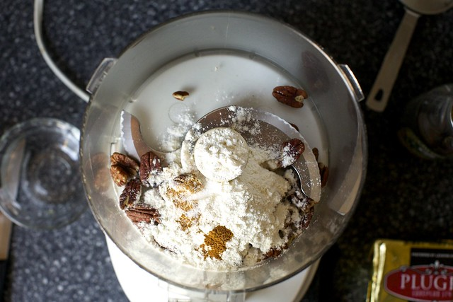 grinding the pecans with flour and spice