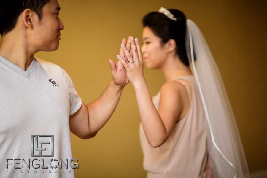 Chinese bride and groom practice their dance