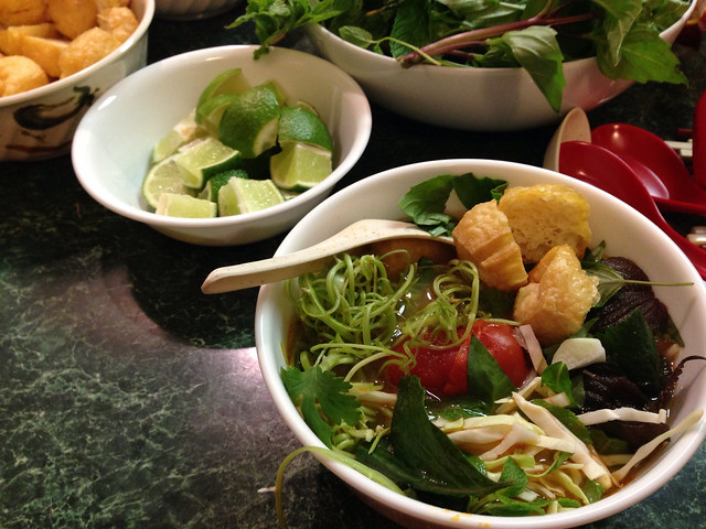 Bun Rieu Cua tomato crab soup with  limes and herbs