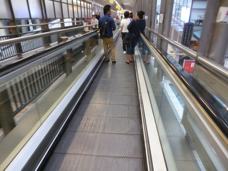 Riding one of the Central Mid-Level escalators