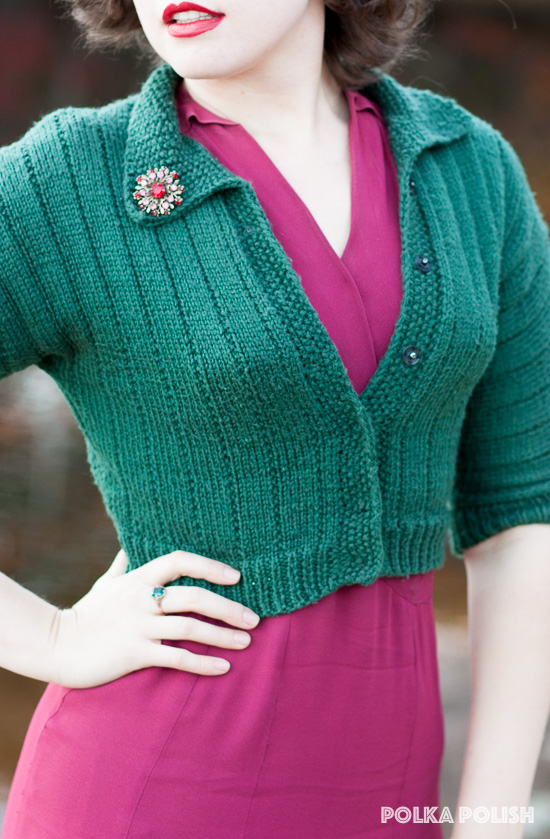 Vintage raspberry pink rayon dress paired with green sweater and shoes paired with a sparkling brooch