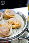 Kimchi Mandoo - Korean style bun dumplings are stuffed with a pork and kimchi filling, and steamed in a metal steamer.