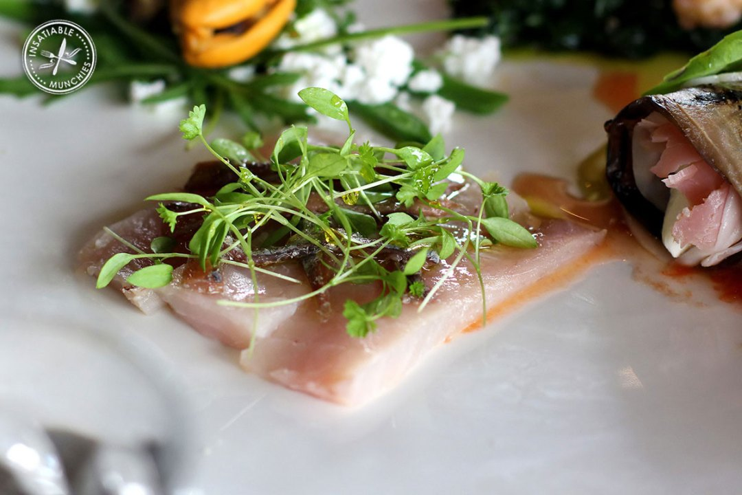 Thin, fresh slices of kingfish are served with a drizzle of olive oil, micro herbs and beautiful scalia anchovies.