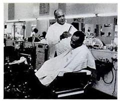 Gardner Bishop in his barbershop: 1974