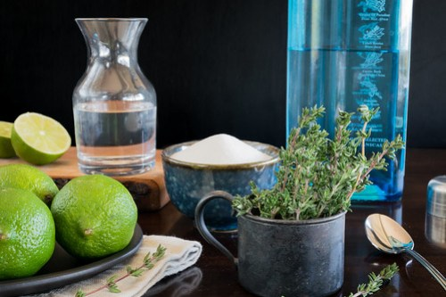 gin, thyme, sugar, and limes