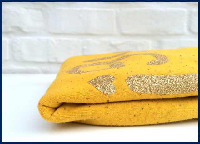 gold sweater (folded)