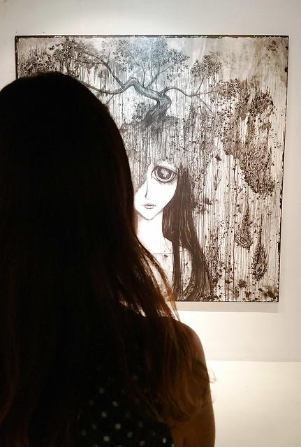 Heather eyeing some art.