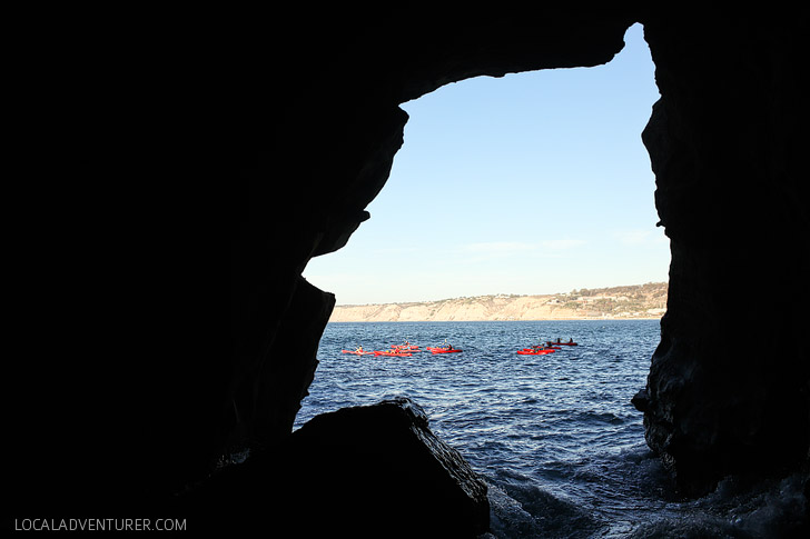 Kayakers near the Sunny Jim Cave - A hidden and historic La Jolla attraction.