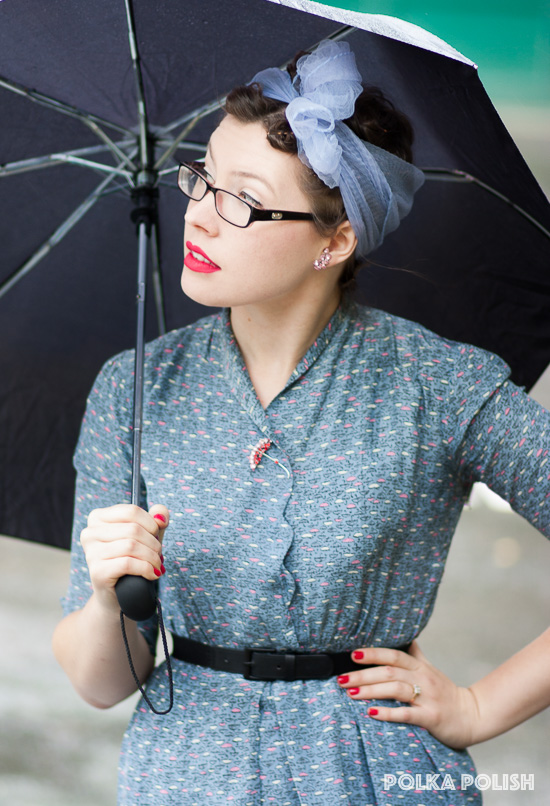 For rainy weather, a vintage novelty print dress in slate blue with pink and white umbrellas, an umbrella pin, and a real umbrella