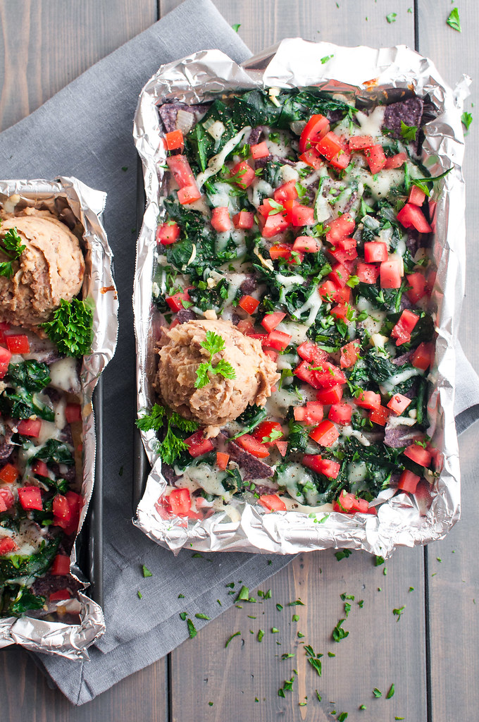 Italian garlic spinach nachos with meatless refried beans