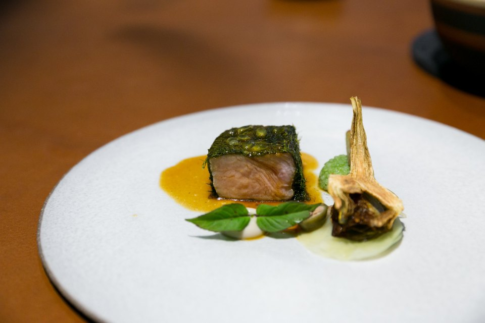 Veal fillet wrapped with seaweed, anchovies, artichokes, rice with herbs, passionfruit sauce at L'air du temps, Belgium