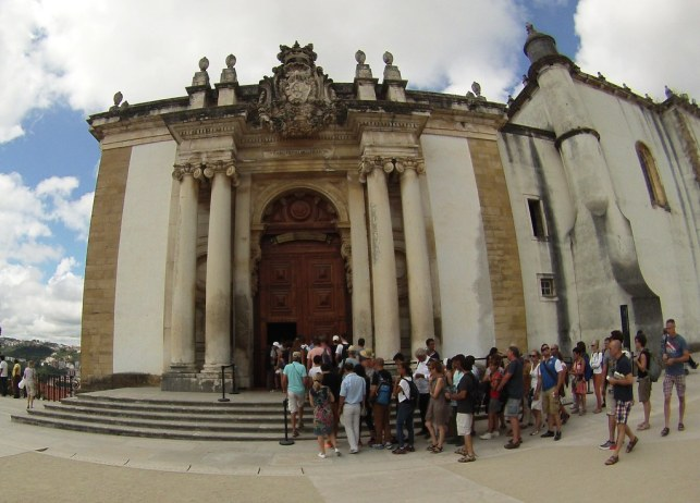 Visitors Wait to Enter Joanina Library at the University of Coimbra, Portugal.
