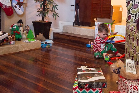 playing with his presents