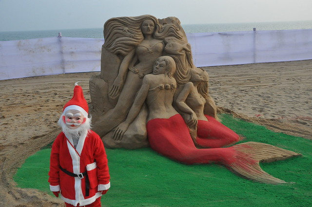 On the eve of Christmas 2015 international renowned sand artist Manas Kumar Sahoo creates sand sculpture on the Golden Sea-Beach, Puri