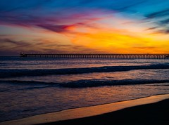 Photograph of a Long Pier during Sunset in Santa Barbara, California, USA in April Spring of 2019.