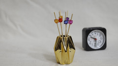 Vase with Swizzle sticks and a Clock