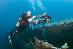BK amputee diving instructor accompanies a novice diver on wreck dive