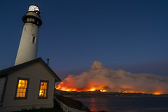 Smoke and fire is seen in the distant mountains from Pigeon Point Lighthouse in Pescadero, California, United States on August 19, 2020. (Photo by Yichuan Cao/Sipa USA)