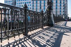 Berlin: Schattenwurf des Geländers der Weidendammer Brücke in der Friedrichstraße - Shadows cast by the wrought-iron railing of the Weidendamm Bridge in the course of Friedrichstraße