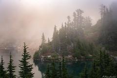 Blue lake, golden fog