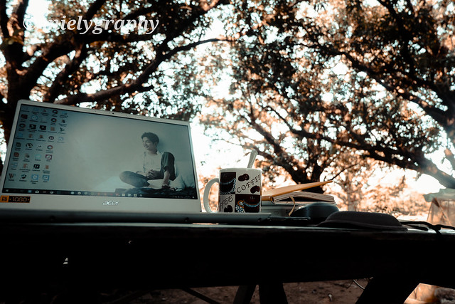 working in front of a field and trees are quite refreshing