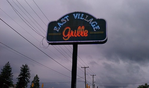 East Village Grille sign, at dusk