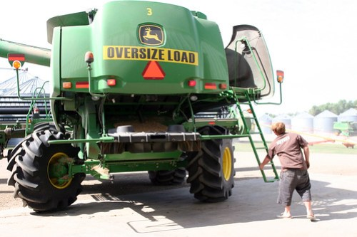 Johan opens up the combine so we can service it.