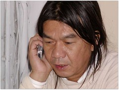 Long Hair (Leung Kwok-hung) on the phone (which is almost always)