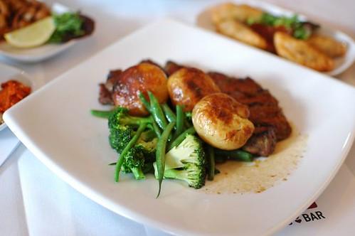 Sirloin tagliatta with duck fat potatoes and greens