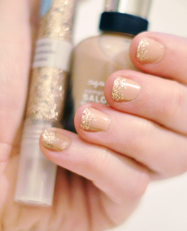 nude nail polish  with  gold glitter tips